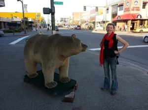 Lauren standing next to a stuffed bear in Anchorage