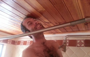 Adrian squished into a very small shower