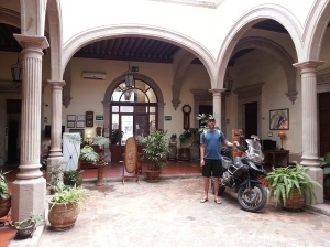 Adrian standing with BMW r1200 GSA in foyer of hotel
