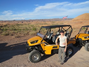 Lauren standing next to an off road vehicle