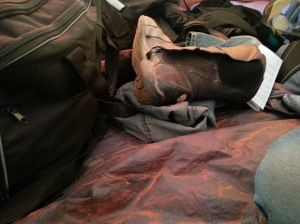 clothes  and a tent floor covered in red dust
