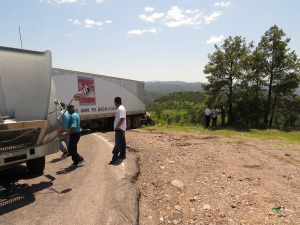 Truck jack-knifed on road, blocking traffic