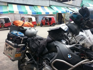 BMW r1200 GSA in on a busy market street just inside Guatemala