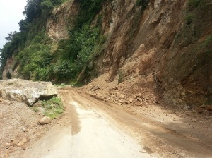 A partially cleared landslide across the road