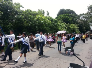 Marching band and dancers on the road in El Salvador
