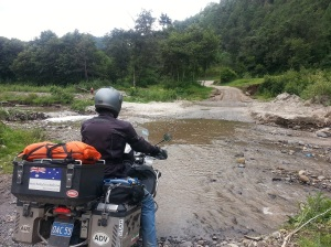 Adrian on his BMW GSA r1200 about to cross a river