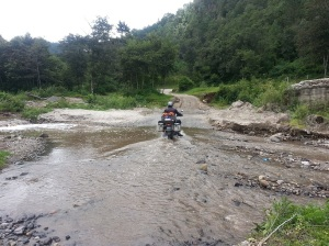 Adrian on his BMW half way across the river