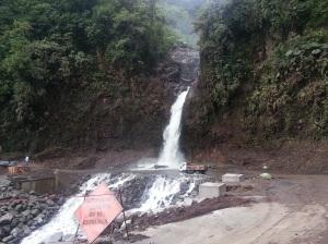 Truck driving through a waterfall