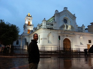 Adrian standing outside a big white church
