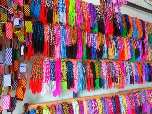 Brightly coloured friendship bracelets made from knotted embroidery thread