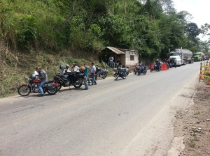 Group of motorbikes at the front of a traffic jam