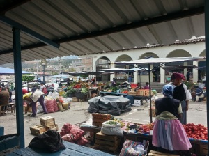 A small fruit market on the street in Otavalo