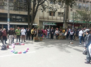 A crowd of people ready for a guinea pig race to start