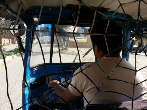 In a tuk tuk in Huanuco