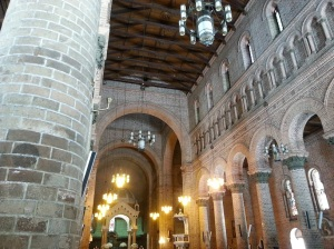 Stone arches and a wooden roof inside a church
