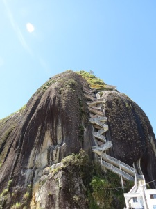 A zigzagging staircase built into a very large rock