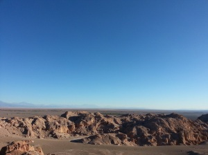 Red rocks against a blue sky in the Atacama desert