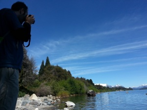 Adrian taking photos of the lake in Bariloche