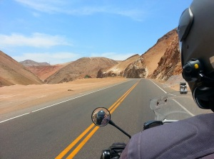 Adrian riding through the desert
